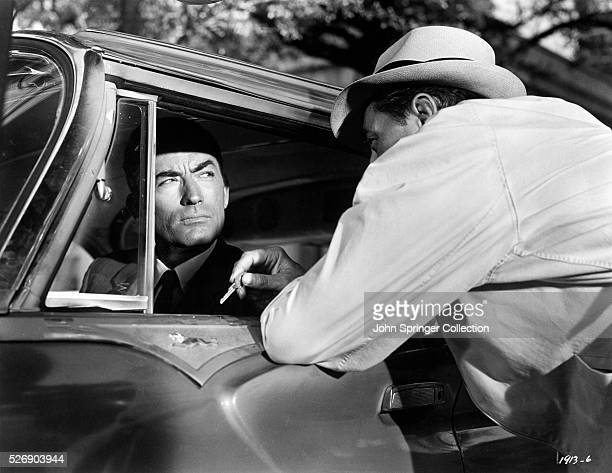 Gregory Peck as Sam Bowden and Robert Mitchum as Max Cady in the 1962 film Cape Fear