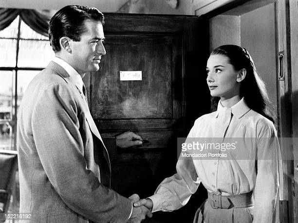 Gregory Peck as the journalist Joe shaking the hand of Audrey Hepburn Princess Ann in a scende from the movie Roman Holiday Rome 1953