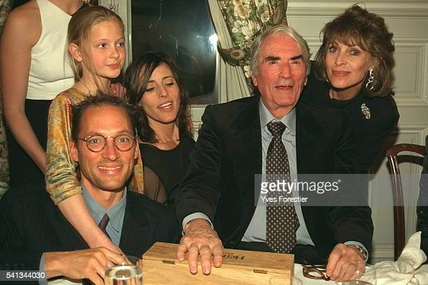 Gregory Peck sits among his family at a birthday celebration in France Beside him is his wife Veronique and son Tony and daughter Cecilia Also...