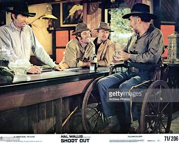 Gregory Peck stepping up to the bar in lobby card for the film 'Shoot Out' 1971
