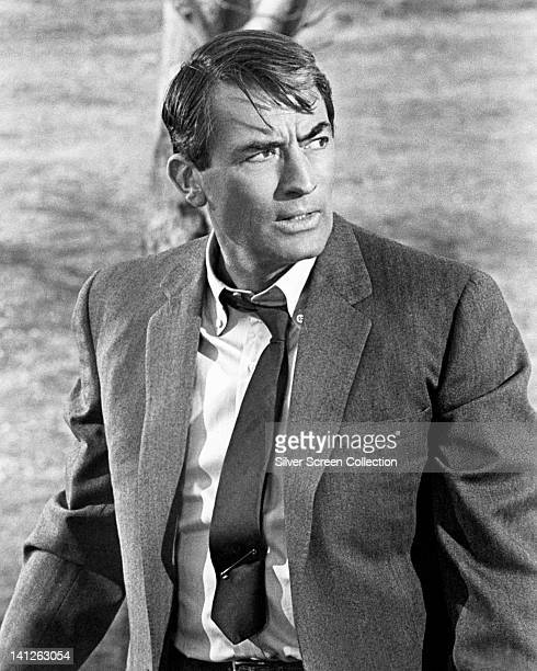 Gregory Peck US actor wearing a grey jacket over a white shirt with a dark tie circa 1965