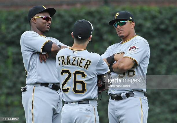 Gregory Polanco Adam Frazier and Jose Osuna of the Pittsburgh Pirates celebrate a win against the Chicago Cubs at Wrigley Field on July 9 2017 in...