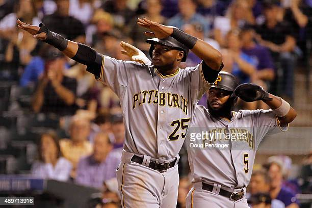 Gregory Polanco and Josh Harrison of the Pittsburgh Pirates celebrate after scoring on a double by Starling Marte of the Pittsburgh Pirates off of...