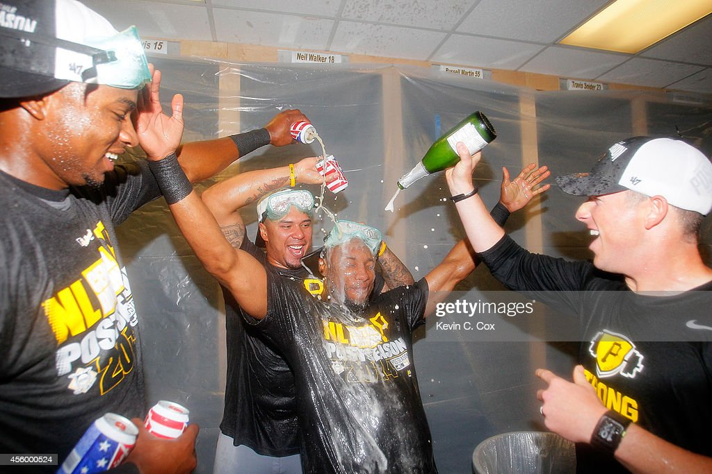 Gregory Polanco Jose Tabata and Starling Marte of the Pittsburgh Pirates celebrate clinching a National League playoff spot after their 32 win over...