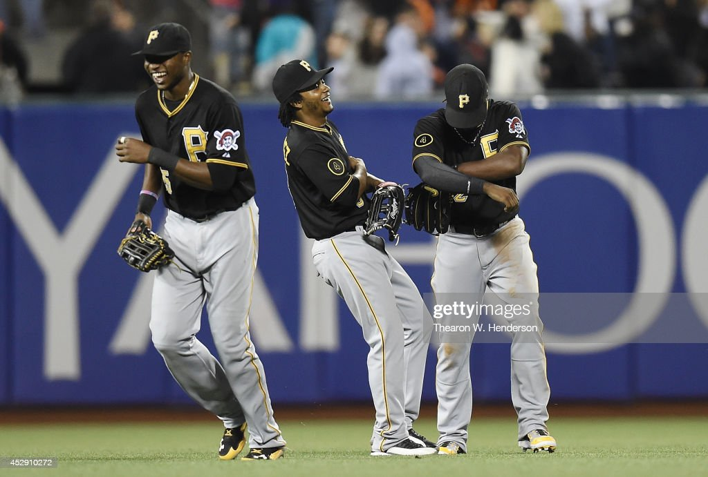 <a gi-track='captionPersonalityLinkClicked' href=/galleries/search?phrase=Gregory+Polanco&family=editorial&specificpeople=11178456 ng-click='$event.stopPropagation()'>Gregory Polanco</a> #25, Michael Martinez #3 and <a gi-track='captionPersonalityLinkClicked' href=/galleries/search?phrase=Andrew+McCutchen&family=editorial&specificpeople=2364814 ng-click='$event.stopPropagation()'>Andrew McCutchen</a> #22 of the Pittsburgh Pirates celebrate defeating the San Francisco Giants 3-1 at AT&T Park on July 29, 2014 in San Francisco, California.