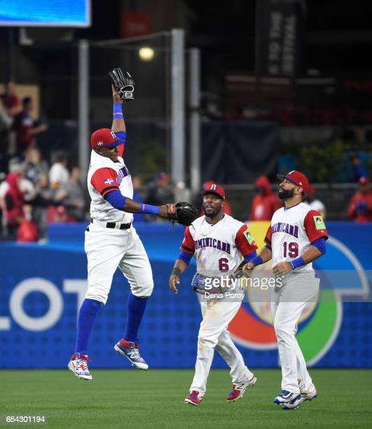 Gregory Polanco of the Dominican Republic left Starling Marte and Jose Bautista celebrate after beating Venezuela 30 in the World Baseball Classic...