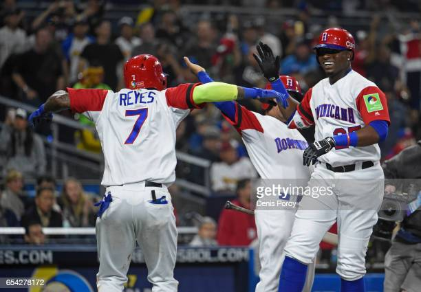 Gregory Polanco of the Dominican Republic right is congratulated by Jose Reyes after hitting a solo home run during the fifth inning of the World...