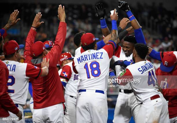 Gregory Polanco of the Dominican Republic rightrear is congratulated by teammates after hitting a solo home run during the fifth inning of the World...