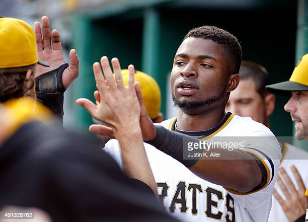 Gregory Polanco of the Pittsburgh Pirates celebrates after scoring on a RBI double in the seventh inning during the game against the Cincinnati Reds...