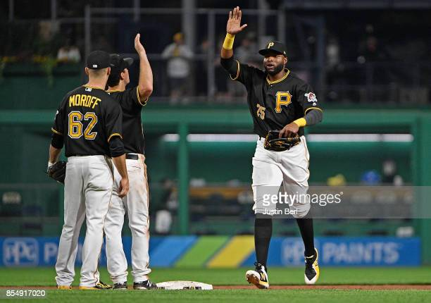 Gregory Polanco of the Pittsburgh Pirates celebrates with Adam Frazier and Max Moroff after the final out in the Pittsburgh Pirates 53 win over the...