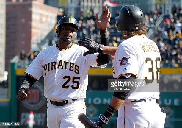 Gregory Polanco of the Pittsburgh Pirates celebrates with Michael Morse after scoring on an RBI double in the eighth inning during opening day...