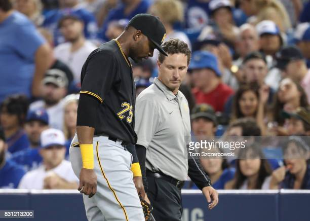 Gregory Polanco of the Pittsburgh Pirates exits the game with a leg injury as he is assisted by the trainer in the fifth inning during MLB game...
