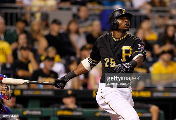 Gregory Polanco of the Pittsburgh Pirates hits a RBI double in the third inning during the game against the Chicago Cubs at PNC Park on August 3 2015...