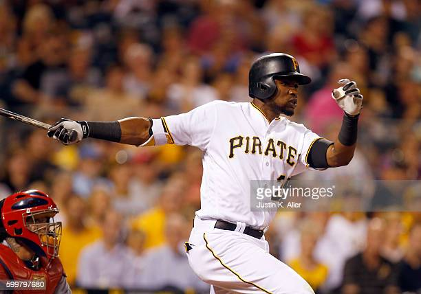 Gregory Polanco of the Pittsburgh Pirates hits a RBI single in the fifth inning during the game against the St Louis Cardinals at PNC Park on...
