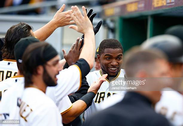 Gregory Polanco of the Pittsburgh Pirates is congratulated by teammates in the dugout after hitting a solo home run in the first inning against the...