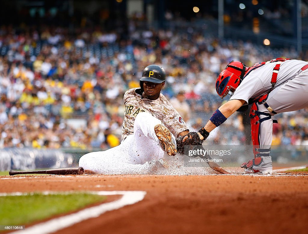 <a gi-track='captionPersonalityLinkClicked' href=/galleries/search?phrase=Gregory+Polanco&family=editorial&specificpeople=11178456 ng-click='$event.stopPropagation()'>Gregory Polanco</a> #25 of the Pittsburgh Pirates is tagged out at home plate by <a gi-track='captionPersonalityLinkClicked' href=/galleries/search?phrase=Yadier+Molina&family=editorial&specificpeople=172002 ng-click='$event.stopPropagation()'>Yadier Molina</a> #4 of the St Louis Cardinals in the first inning during the game at PNC Park on July 9, 2015 in Pittsburgh, Pennsylvania.