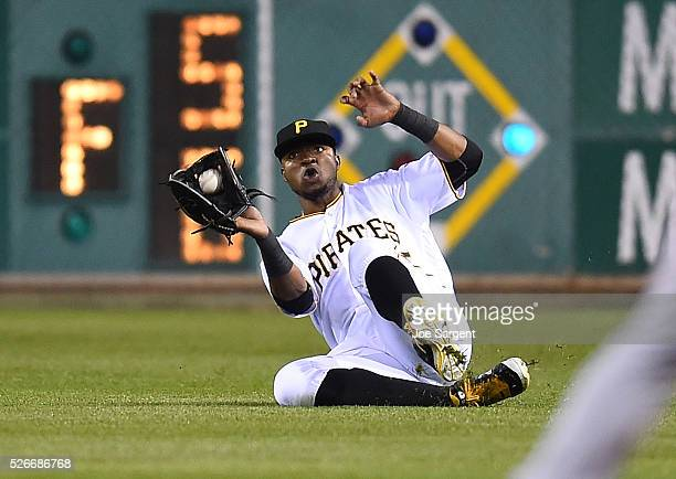 Gregory Polanco of the Pittsburgh Pirates makes a diving catch on a ball hit by Jordan Pacheco of the Cincinnati Reds during the seventh inning on...