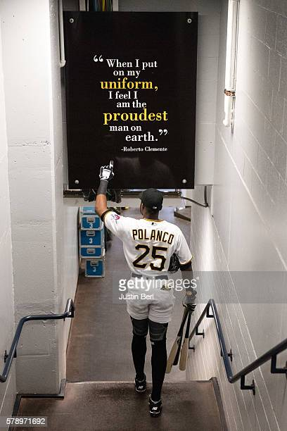 Gregory Polanco of the Pittsburgh Pirates points to a sign honoring Roberto Clemente as he heads towards the dugout before the game against the...