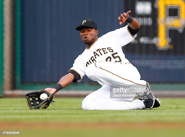 Gregory Polanco of the Pittsburgh Pirates reaches but loses a sliding catch attempt in the first inning against the Cincinnati Reds during the game...