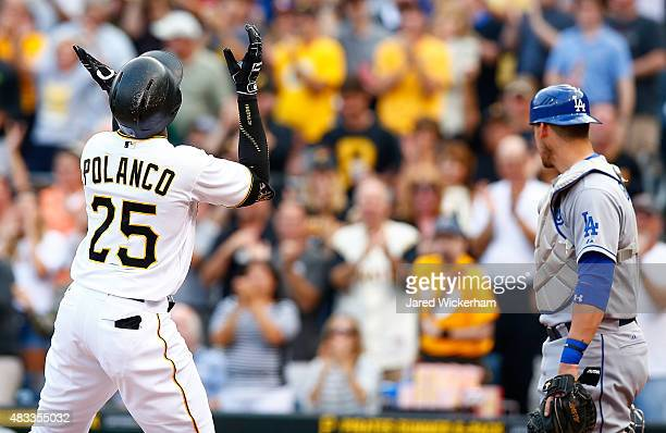 Gregory Polanco of the Pittsburgh Pirates reacts after crossing home plate following his solo home run in the first inning against the Los Angeles...