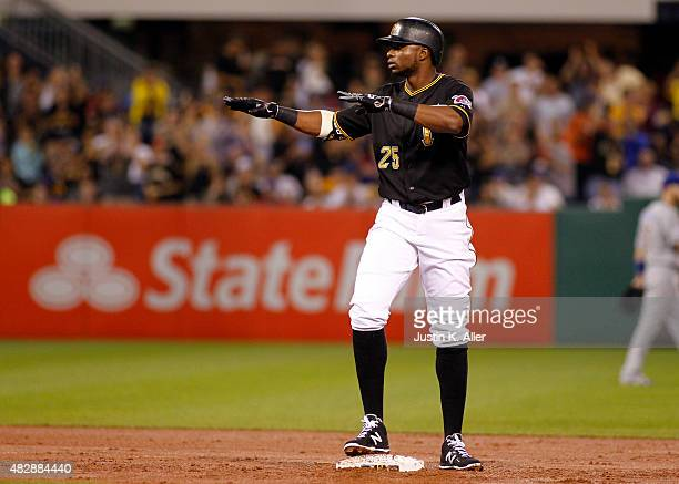 Gregory Polanco of the Pittsburgh Pirates reacts after hitting a RBI double in the third inning during the game against the Chicago Cubs at PNC Park...