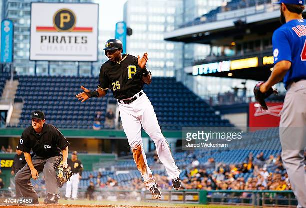 Gregory Polanco of the Pittsburgh Pirates reacts after scoring in the first inning against the Chicago Cubs during the game at PNC Park on April 20...