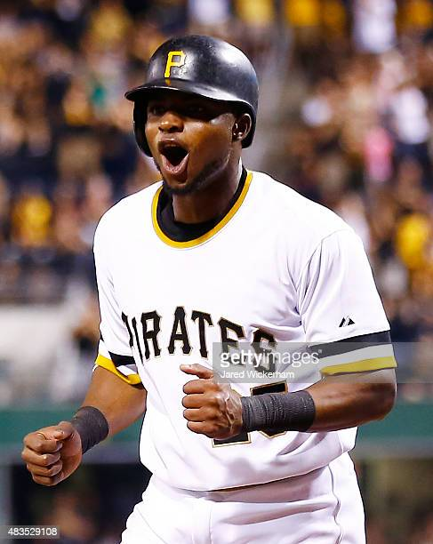 Gregory Polanco of the Pittsburgh Pirates reacts after scoring in the 7th inning against the Los Angeles Dodgers during the game at PNC Park on...