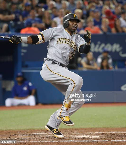 Gregory Polanco of the Pittsburgh Pirates reacts as he fouls a ball off his foot in the sixth inning during MLB game action against the Toronto Blue...