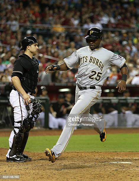Gregory Polanco of the Pittsburgh Pirates scores a run past catcher Miguel Montero of the Arizona Diamondbacks during the MLB game at Chase Field on...