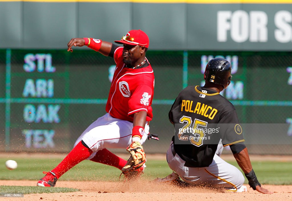 Gregory Polanco #25 of the Pittsburgh Pirates sides in safe ahead of the tag by Brandon Phillips #4 of the Cincinnati Reds at Great American Ball Park on September 27, 2014 in Cincinnati, Ohio.