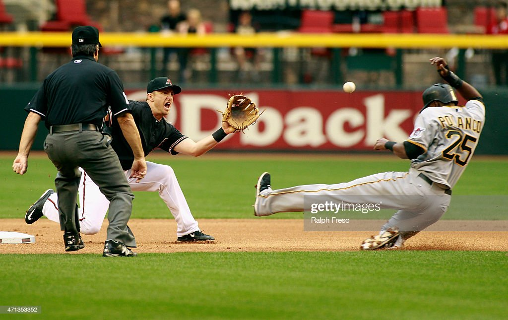 Gregory Polanco of the Pittsburgh Pirates slides into second as shortstop Cliff Penningtgon of the Arizona Diamondbacks fields the throw on a steal...