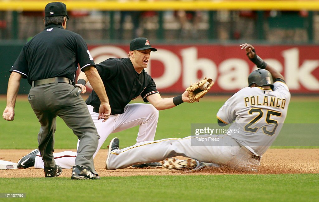 Gregory Polanco of the Pittsburgh Pirates slides safely under the tag of shortstop Cliff Penningtgon of the Arizona Diamondbacks as he steals second...