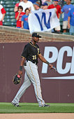 Gregory Polanco of the Pittsburgh Pirates walks off the field after slipping and falling trying to catch a ball hit by Matt Szczur of the Chicago...