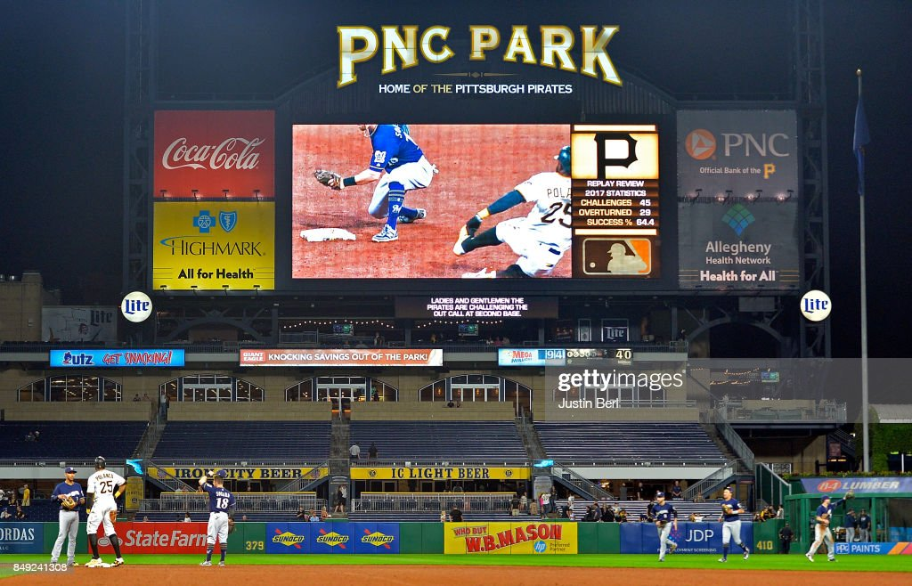 Gregory Polanco #25 of the Pittsburgh Pirates watches a video replay of his slide at second base that was challenged by the Pirates in the ninth inning during the game against the Milwaukee Brewers at PNC Park on September 18, 2017 in Pittsburgh, Pennsylvania.