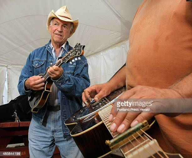 Al Hawkes left plays the mandolin and Dan Burke foreground plays a dobro during a picking circle at the opening day of the Ossipee Valley Bluegrass...