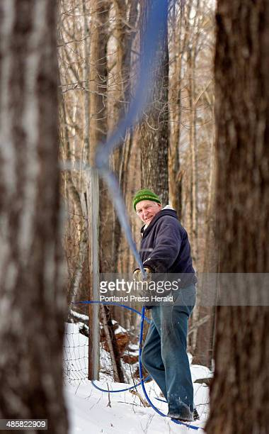 Gregory Rec/Staff Photographer Alden Gile runs tubing through the woods on Carpenter Hill in Alfred on Thrusday January 8 2008 Gile's Family Farm is...