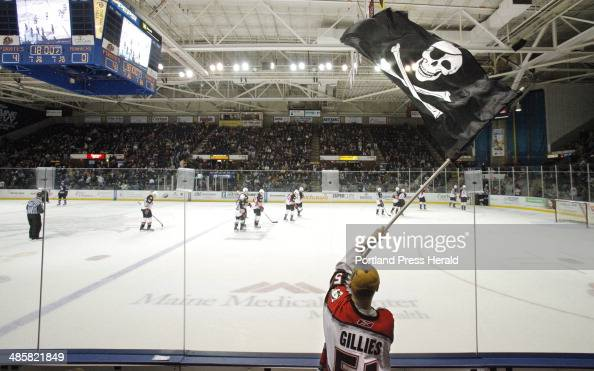 Gregory Rec/Staff Photographer Dan Bailey of Yarmouth waves the Jolly Roger at the end of the second period during Friday night's game between the...