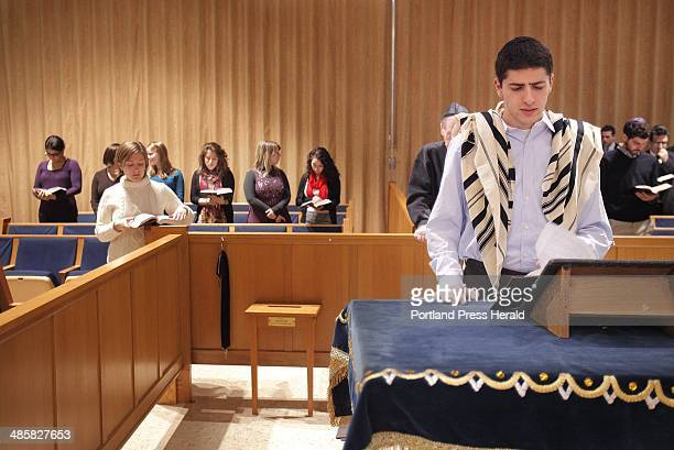 Jacob Agi a student from Brandeis University leads afternoon prayers before the start of the Shabbat eve service at Shaarey Tphiloh Synagogue in...