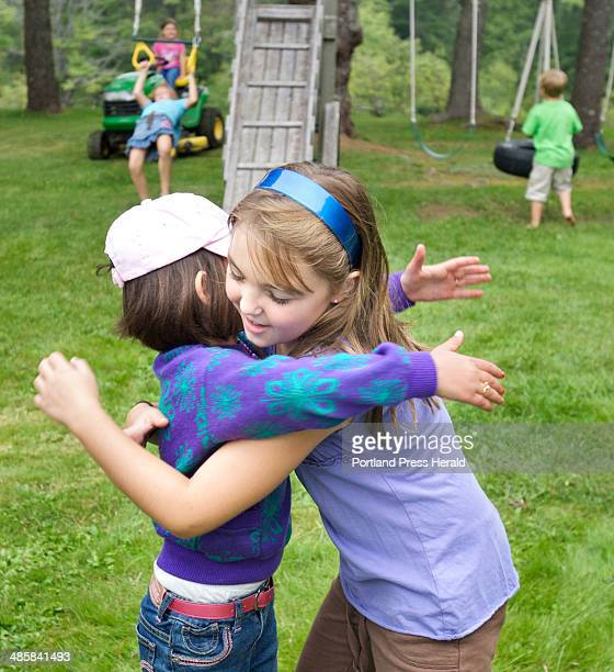 Noora Afif Abdulhameed gets a hug from Claire McGlinn as she leave's McGlinn's house in Falmouth where she had a playdate on Saturday September 13...