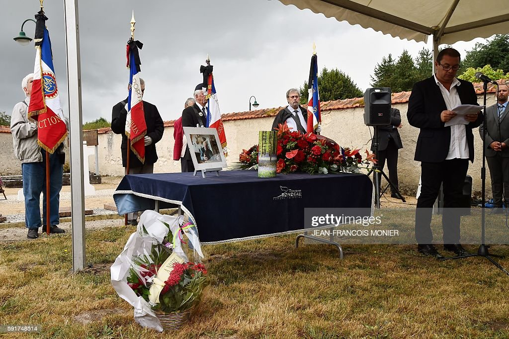 Gregory Roux secretary general of the CGT railway speaks as he stands next to the urn during the funeral of Georges Seguy former secretary general of...