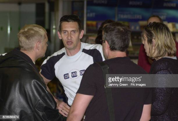 Gregory Saxby from Eastbourne in East Sussex is met by friends at Heathrow Airport in southwest London Saturday May 10 following his release from...