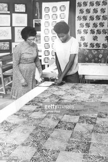 Gregory Scott prints Geometric Design On Cloth Mrs Lula Jacobs art teacher instructs him in process Credit Denver Post Photo