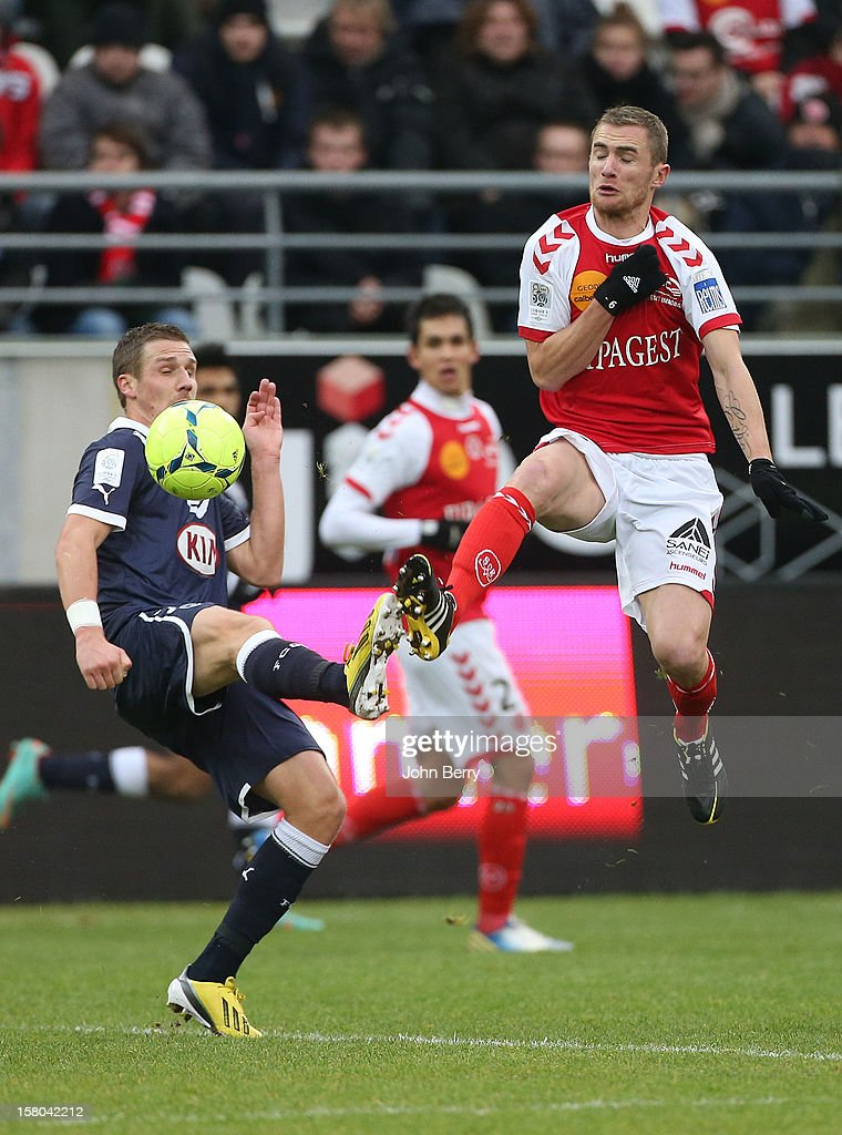 <a gi-track='captionPersonalityLinkClicked' href=/galleries/search?phrase=Gregory+Sertic&family=editorial&specificpeople=5853019 ng-click='$event.stopPropagation()'>Gregory Sertic</a> of Bordeaux fights for the ball with Antoine Devaux of Reims during the French Ligue 1 match between Stade de Reims and Girondins de Bordeaux at the Stade Auguste Delaune on December 9, 2012 in Reims, France.