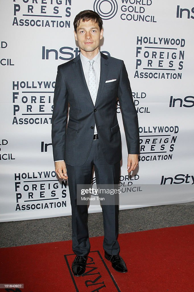 Gregory Smith arrives at the Instyle and the Hollywood Foreign Press Association Party during the 2012 Toronto International Film Festival held at Windsor Arms Hotel on September 11, 2012 in Toronto, Canada.