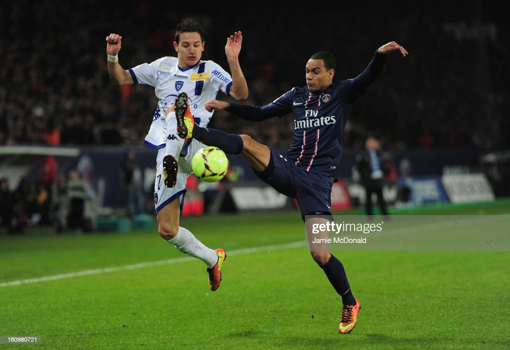 Gregory Van Der Weil of Paris Saint-Germain battles with Floran Thauvin of SC Bastia during the Ligue 1 match between Paris Saint-Germain FC and SC Bastia at Parc des Princes on February 8, 2013 in Paris, France.