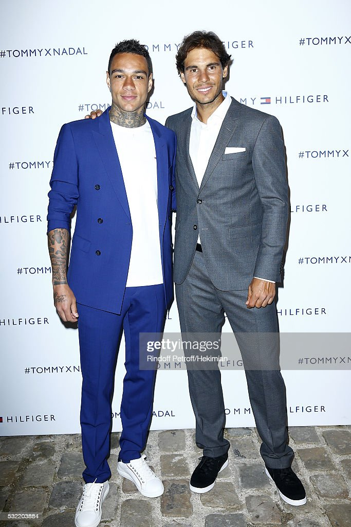 <a gi-track='captionPersonalityLinkClicked' href=/galleries/search?phrase=Gregory+van+der+Wiel&family=editorial&specificpeople=4187227 ng-click='$event.stopPropagation()'>Gregory van der Wiel</a> and <a gi-track='captionPersonalityLinkClicked' href=/galleries/search?phrase=Rafael+Nadal&family=editorial&specificpeople=194996 ng-click='$event.stopPropagation()'>Rafael Nadal</a> attend the Tommy X Nadal party hosted by Tommy Hilfigeron May 18, 2016 in Paris, France.