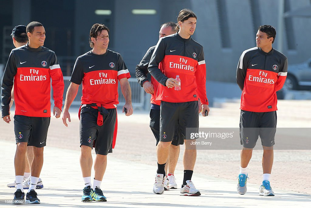 Gregory Van Der Wiel, Maxwell, Zlatan Ibrahimovic and Thiago Silva of PSG chat on their way to the Paris Saint Germain training session held at the Aspire Academy for Sports Excellence on December 30, 2012 in Doha, Qatar.