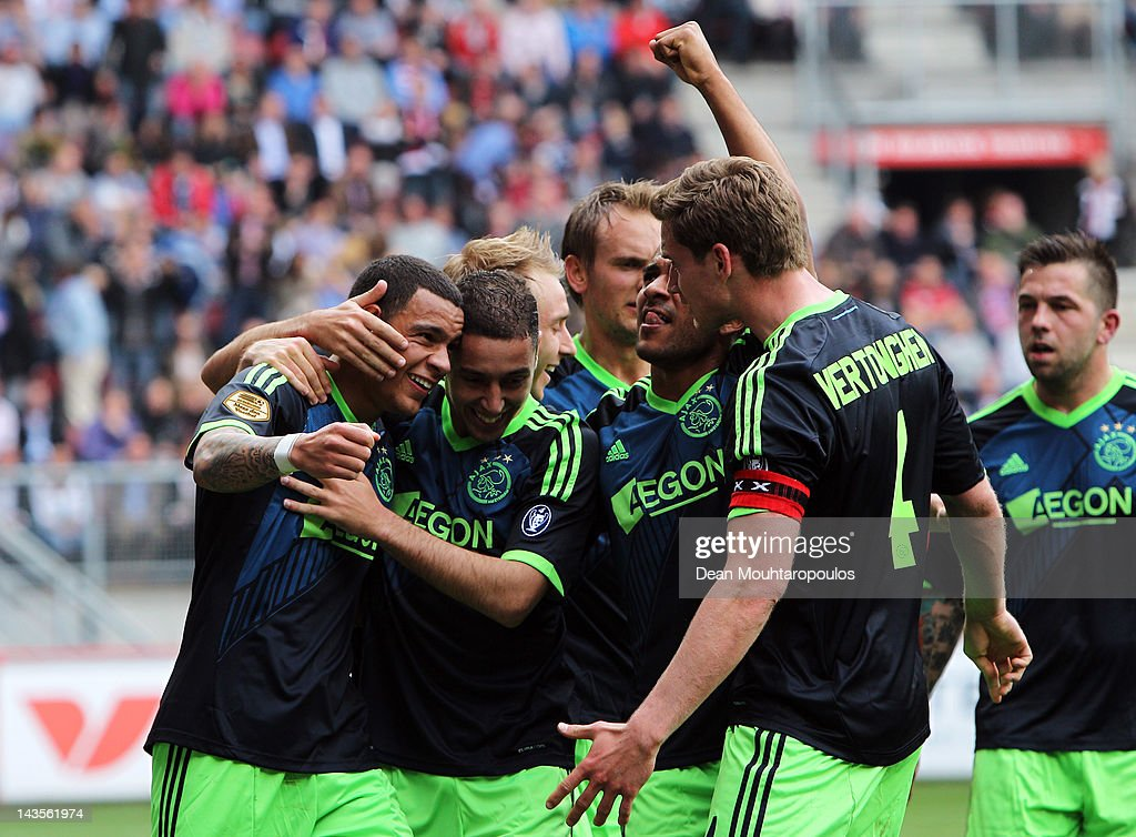 Gregory van der Wiel (L) of Ajax celebrates with his team mates after scoring his teams second goal during the Eredivisie match between FC Twente and Ajax Amsterdam at De Grolsch Veste Stadium on April 29, 2012 in Enschede, Netherlands.