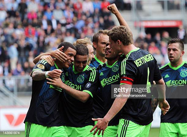Gregory van der Wiel of Ajax celebrates with his team mates after scoring his teams second goal during the Eredivisie match between FC Twente and...
