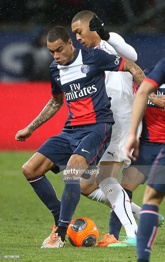 Gregory Van Der Wiel of PSG and <a gi-track='captionPersonalityLinkClicked' href=/galleries/search?phrase=Guillaume+Hoarau&family=editorial&specificpeople=5223496 ng-click='$event.stopPropagation()'>Guillaume Hoarau</a> of Bordeaux in action during the Ligue 1 match between Paris Saint-Germain FC and FC Girondins de Bordeaux at the Parc des Princes stadium on January 31, 2014 in Paris, France.